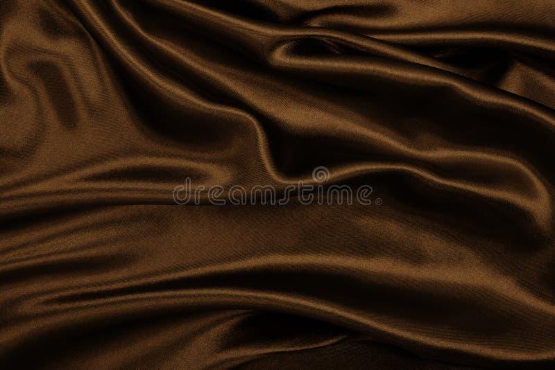 Struttura marrone elegante regolare del raso o della seta come backgroun astratto fotografia stock libera da diritti