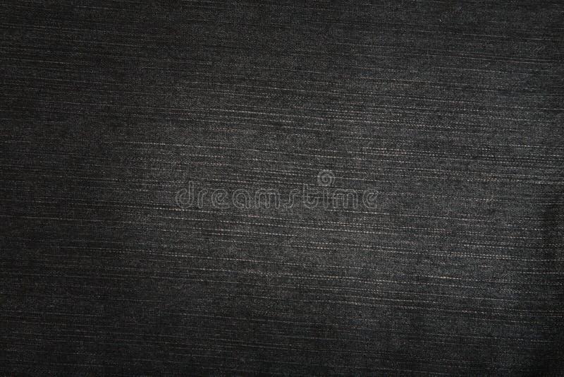 Struttura nera dei jeans fotografia stock