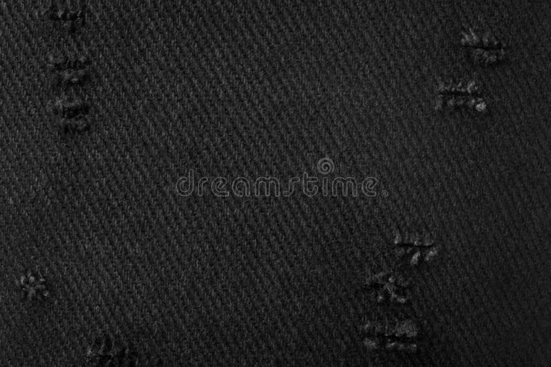 Struttura nera del tessuto Fondo di materiale scuro fatto dal panno Tessuto lacerato fotografia stock