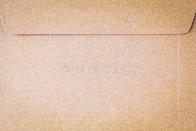 Struttura o fondo del primo piano della carta marrone del cartone fotografia stock libera da diritti
