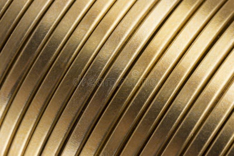 Struttura ondulata del metallo dell'oro fotografia stock