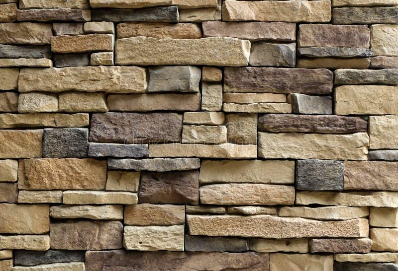 Struttura orizzontale della parete di pietre asimmetrica immagini stock