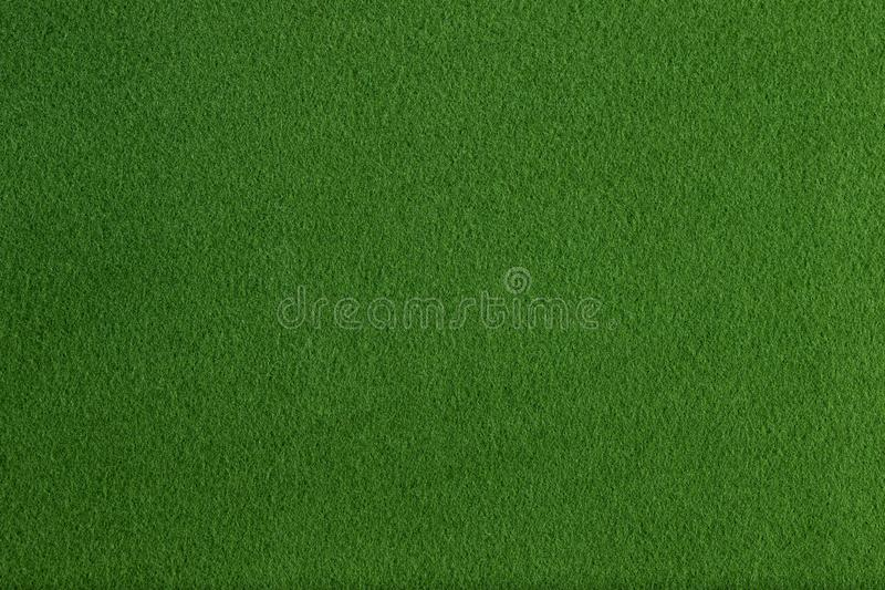 Struttura piana e fondo del vello sintetico verde fotografia stock