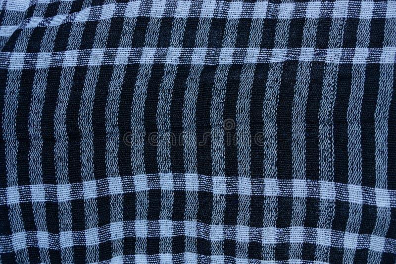 Struttura a quadretti del tessuto su un pezzo di lana di abbigliamento fotografia stock libera da diritti