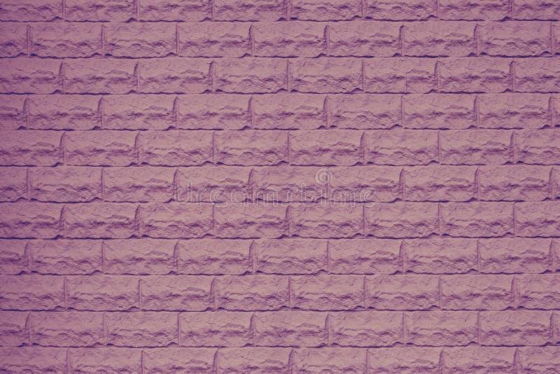 Struttura rosa del muro di mattoni Parete di pietra porpora decorativa Spazio vuoto Modello del muro di mattoni viola Parete porp immagine stock