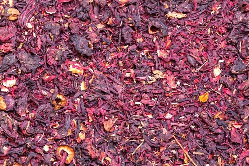 Struttura rossa asciutta del fondo dell'ibisco del tè fotografie stock libere da diritti