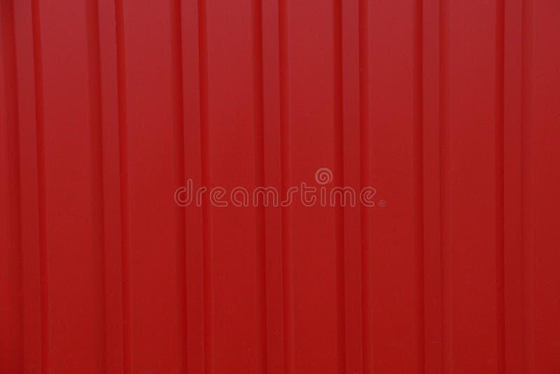 Struttura rossa del ferro da un frammento di un recinto fotografia stock libera da diritti