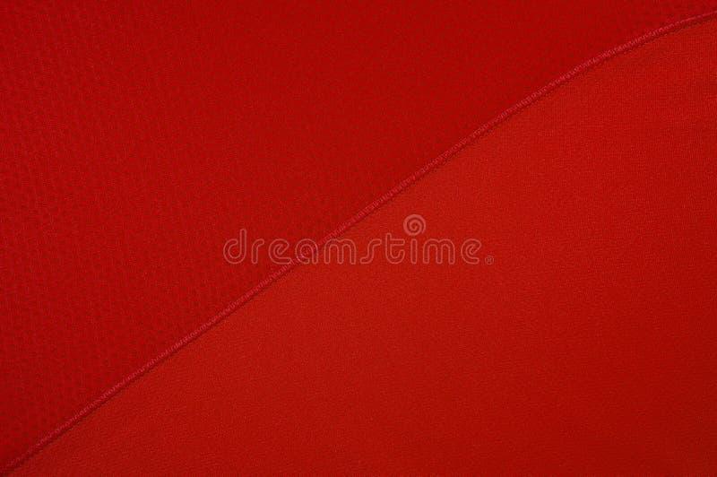 Struttura rossa del tessuto dell'abbigliamento di sport fotografia stock libera da diritti
