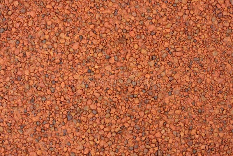 Struttura rossa della ghiaia della laterite per fondo immagine stock libera da diritti