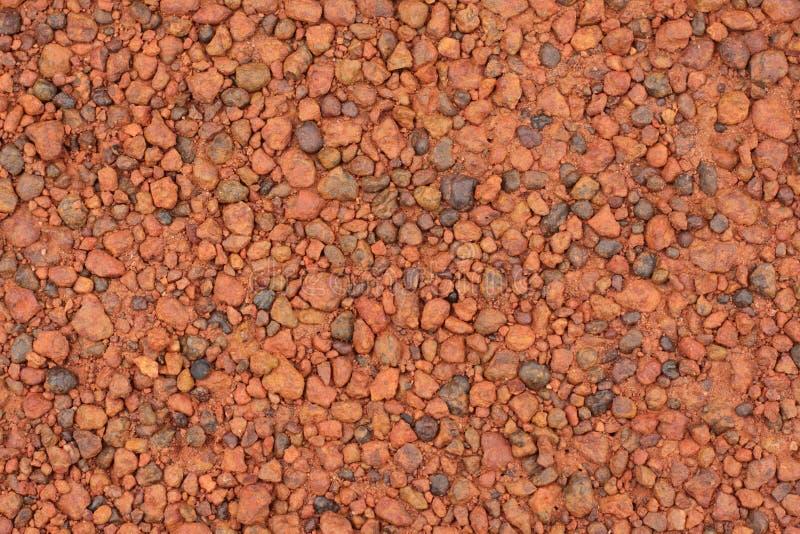 Struttura rossa della ghiaia della laterite per fondo fotografia stock libera da diritti