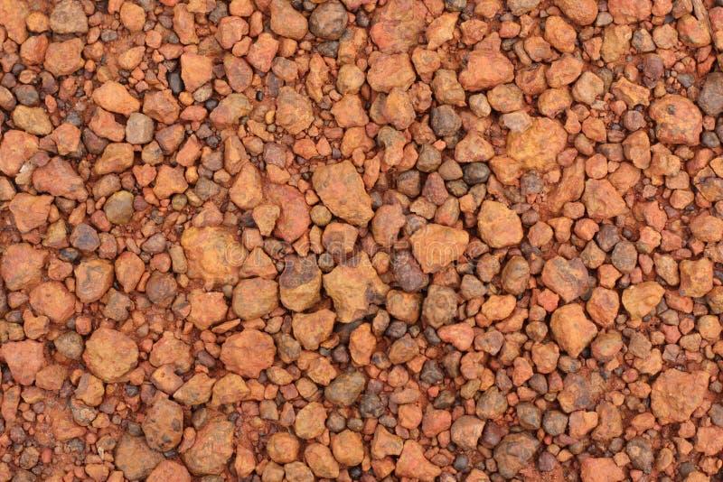 Struttura rossa della ghiaia della laterite per fondo fotografie stock libere da diritti