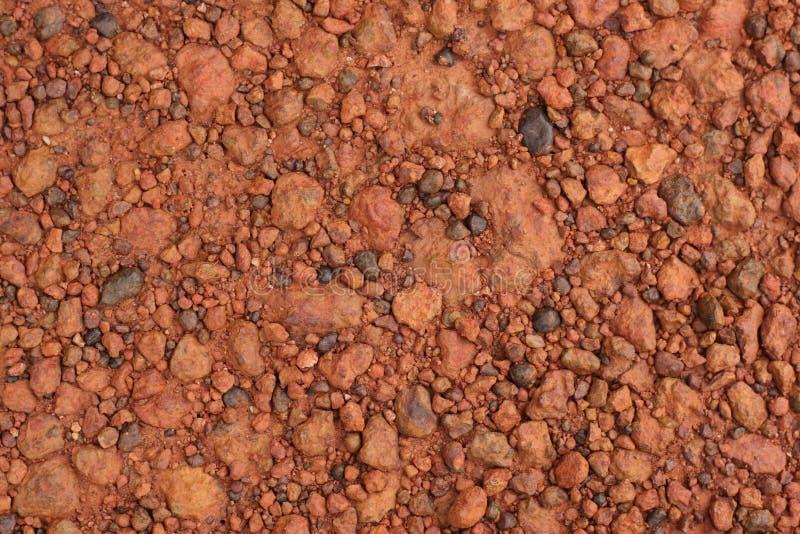 Struttura rossa della ghiaia della laterite per fondo immagini stock libere da diritti