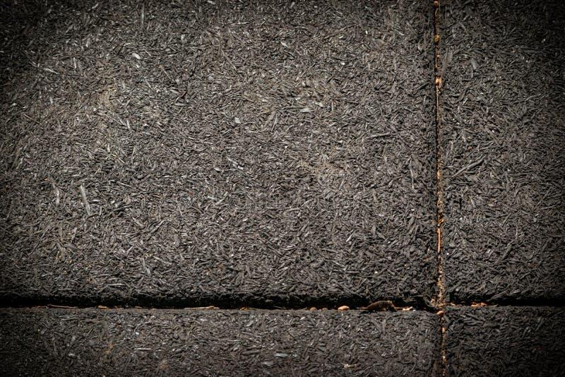 Struttura scura fatta dalle mattonelle di gomma fotografie stock