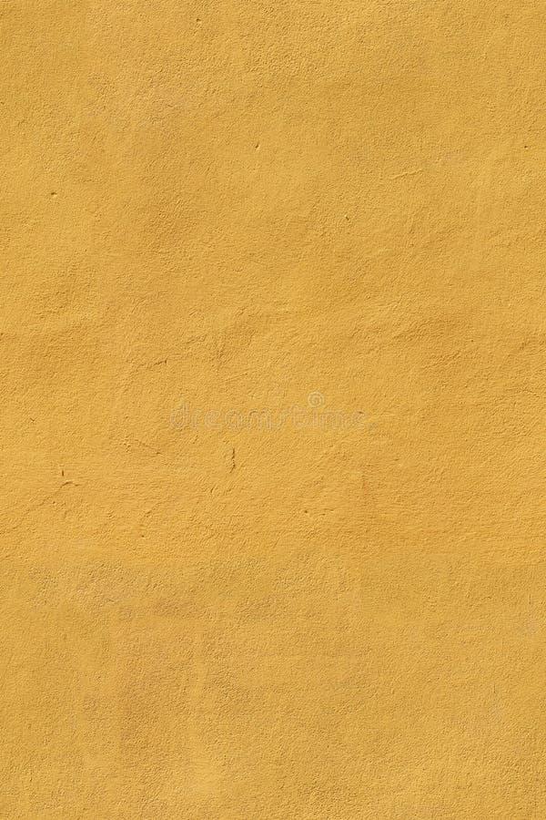 Struttura senza cuciture gialla dello stucco fotografia stock