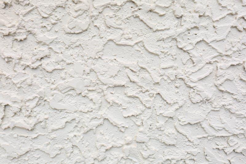 Struttura spessa pesante dello stucco del cemento della sabbia sulla parete fotografie stock libere da diritti