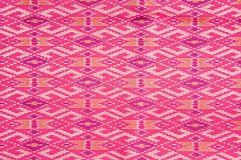 Struttura tailandese rosa variopinta del tessuto di seta fotografia stock