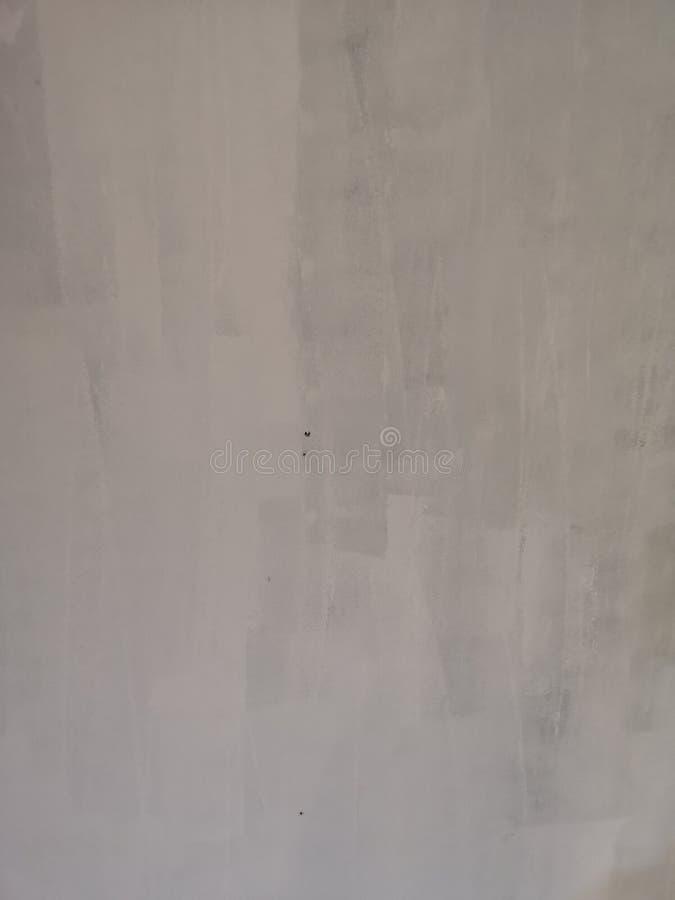 Struttura unfinish di superficie ruvida di colore bianco della pittura murale del cemento fotografia stock libera da diritti
