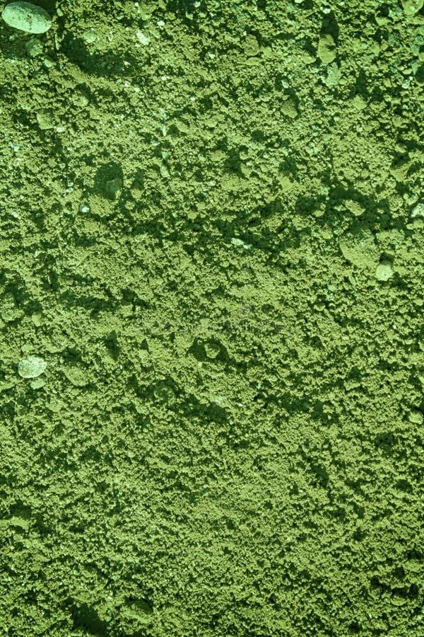 Struttura verde di gesso sulla parete, fondo incrinato, surfac di pietra immagini stock