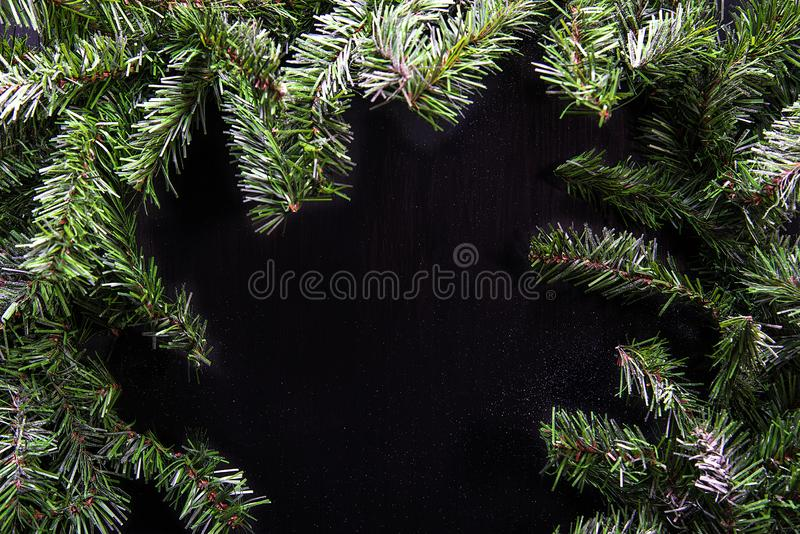 Struttura verde di Natale isolata su fondo nero immagini stock libere da diritti