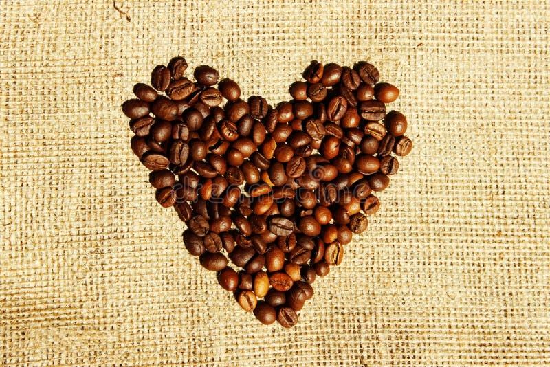 Strutture del caff? di Brown Cuore del caffè sopra il fondo del tessuto Isolated astratto Isolated astratto immagine stock