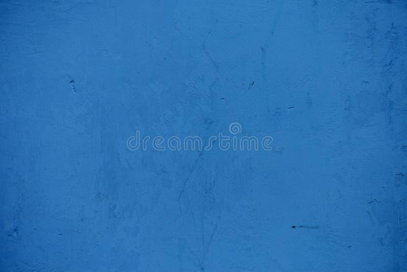 Strutture sulla parete blu, per fondo immagini stock