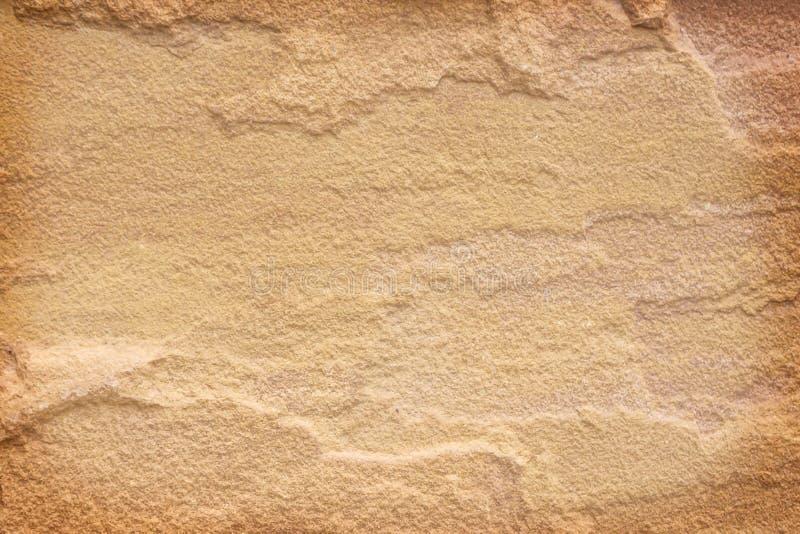 Strutturi il fondo astratto naturale dei modelli marroni dell'arenaria immagine stock