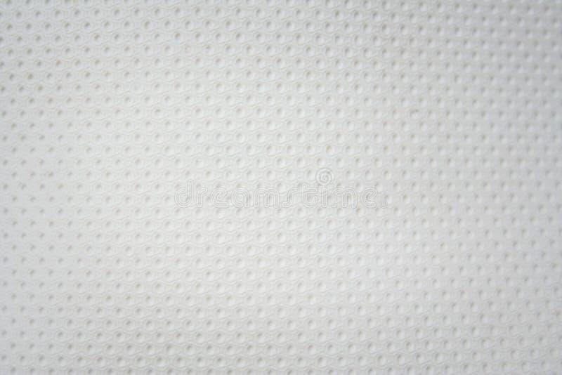 Strutturi il modello di foro senza cuciture bianco di similpelle, fondo bianco immagini stock