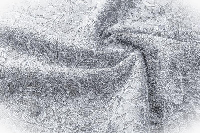 Strutturi l'immagine di sfondo, tessuto in bianco e nero con un modello immagini stock