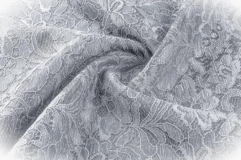 Strutturi l'immagine di sfondo, tessuto in bianco e nero con un modello fotografie stock