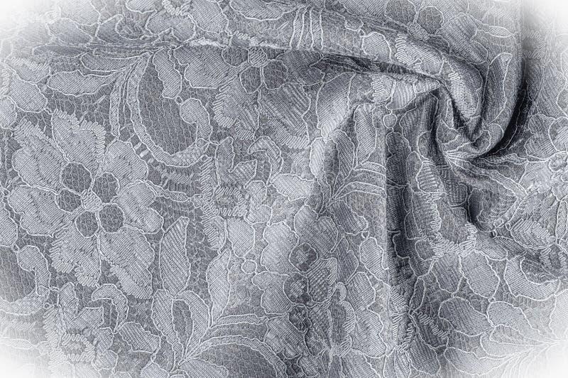 Strutturi l'immagine di sfondo, tessuto in bianco e nero con un modello fotografia stock libera da diritti