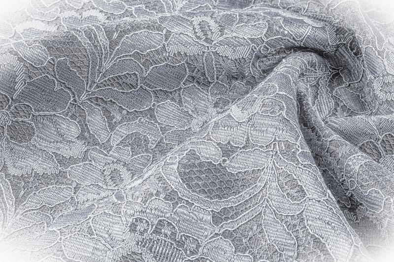 Strutturi l'immagine di sfondo, tessuto in bianco e nero con un modello fotografia stock