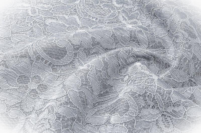 Strutturi l'immagine di sfondo, tessuto in bianco e nero con un modello fotografie stock libere da diritti