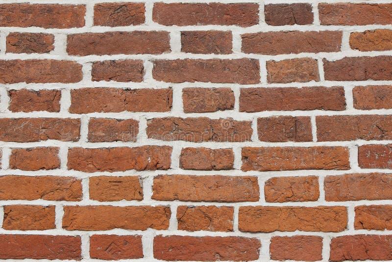 Strutturi la parete del mattone obsoleto rosso Fondo da vecchia muratura arancio con bianco fotografia stock libera da diritti