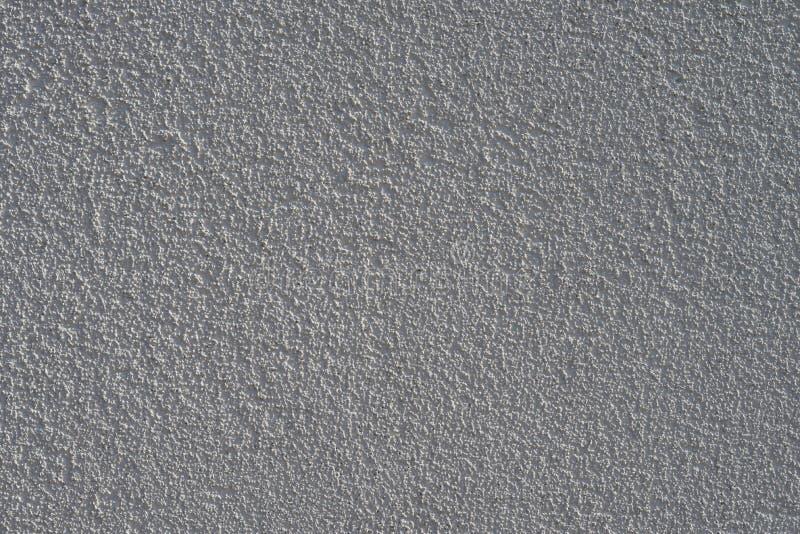 Strutturi la parete luminosa del gesso con una superficie convessa immagini stock