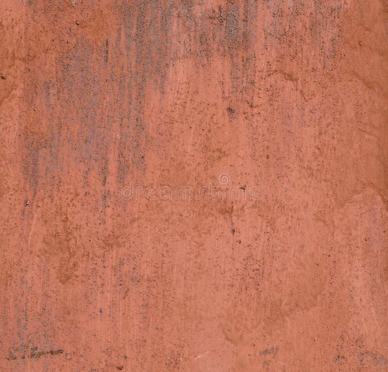 Strutturi la vecchia superficie di metallo dipinta, pittura arancio con ruggine fotografie stock