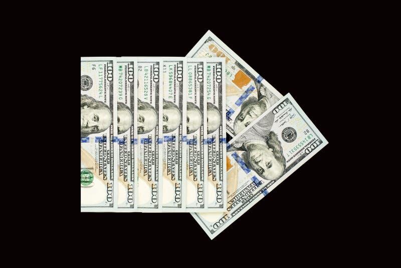 Strzałkowaty pointer dolara amerykańskiego pieniądze gotówka na blackboard tle fotografia stock