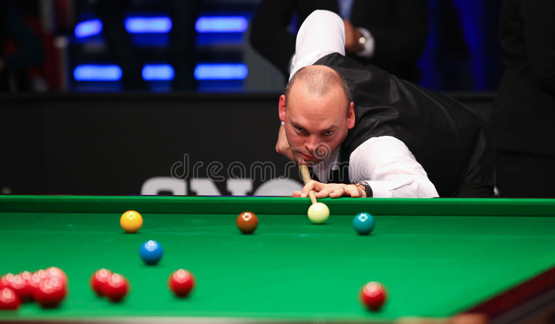 Stuart Bingham. Of England pictured during a snooker friendly match against Ronnie O'Sullivan, in Bucharest, Romania, Saturday, 21 November 2015 royalty free stock photo