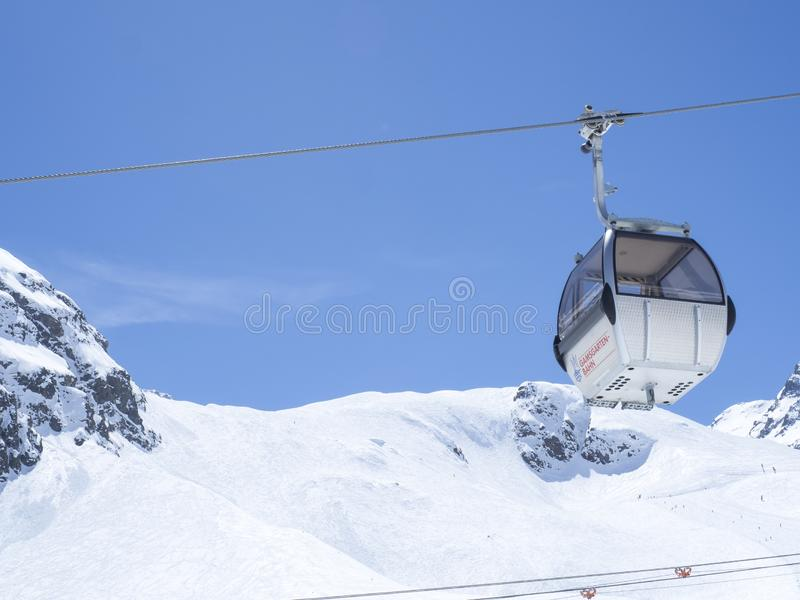 Stubai Glacier, AUSTRIA, May 2, 2019: white cable car ski lift cabin going on the top of Schaufelspitze mountain at royalty free stock image