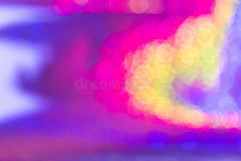 Stubarwnej abstrakcjonistycznej tęczy neonowy holograficzny jaskrawy tło z gradientowym jaśnieniem z bokeh skutkiem menchie i  fotografia stock