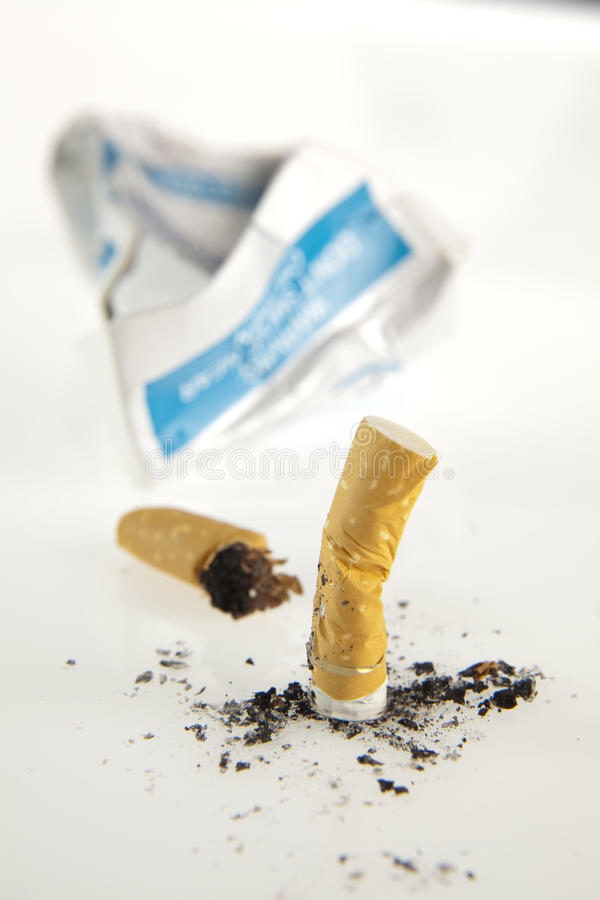 Stubbed out cigarettes stock image