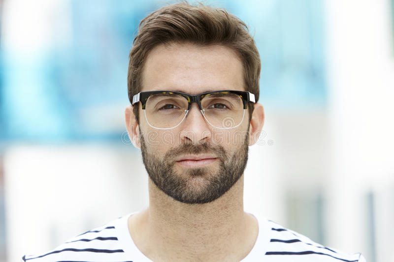 Stubble man in spectacles royalty free stock photos