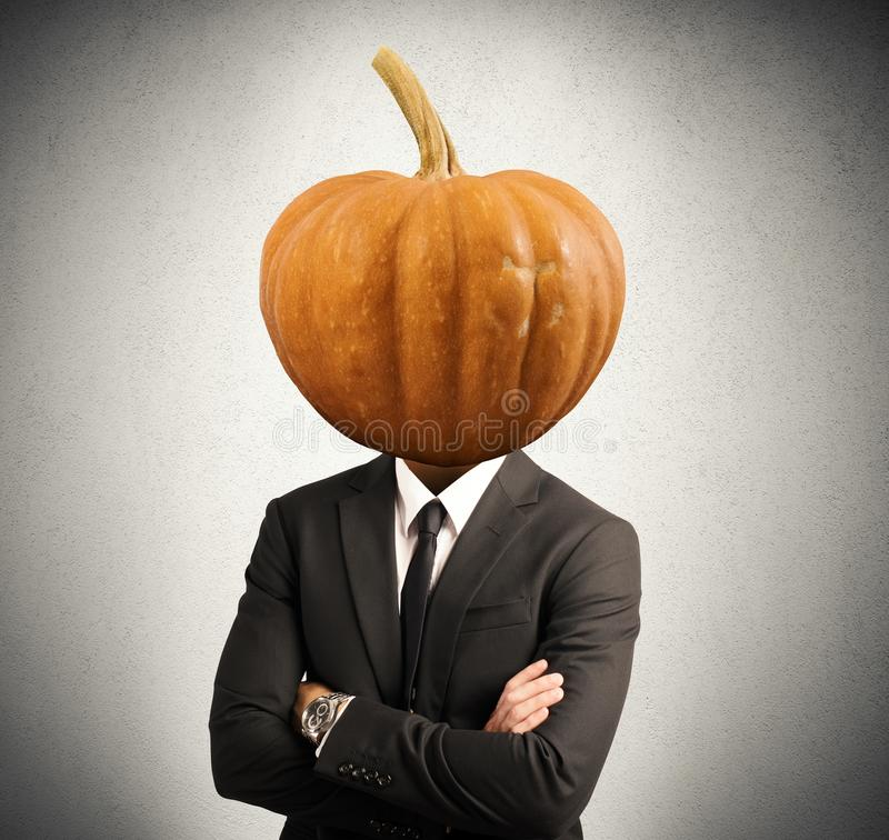 Stubborn businessman. Concept of stubborn businessman with pumpkin in head stock photos