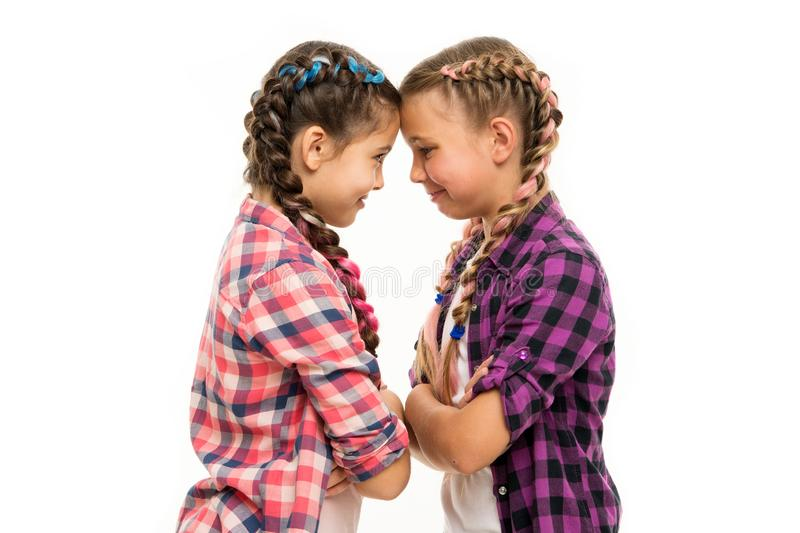 Stubborn concept. Stubborn kids. Disagreement and stubbornness. Girls offended friends. Kids sisters looks strictly. Stubborn temper. Girls folded arms on royalty free stock photography