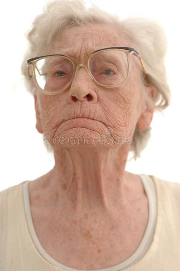 Stubborn Granny. Portrait of a stubborn mature woman in her eighties. Photographed on white royalty free stock photos