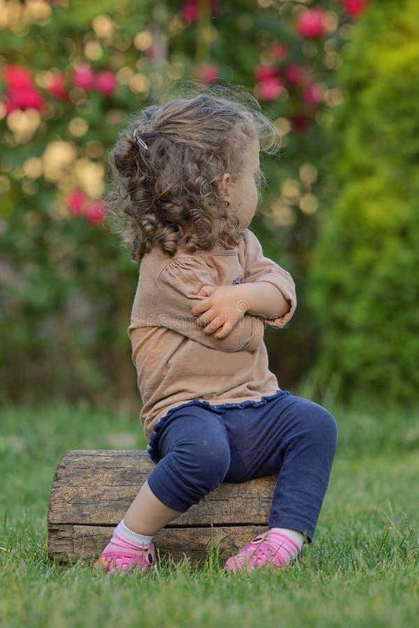 Stubborn little girl. In garden royalty free stock photos