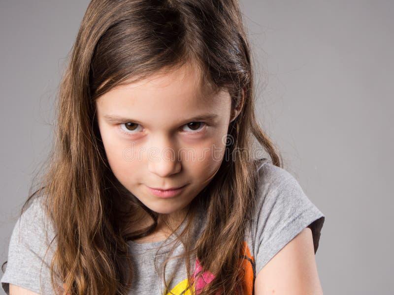 Stubborn little girl. In studio stock photos