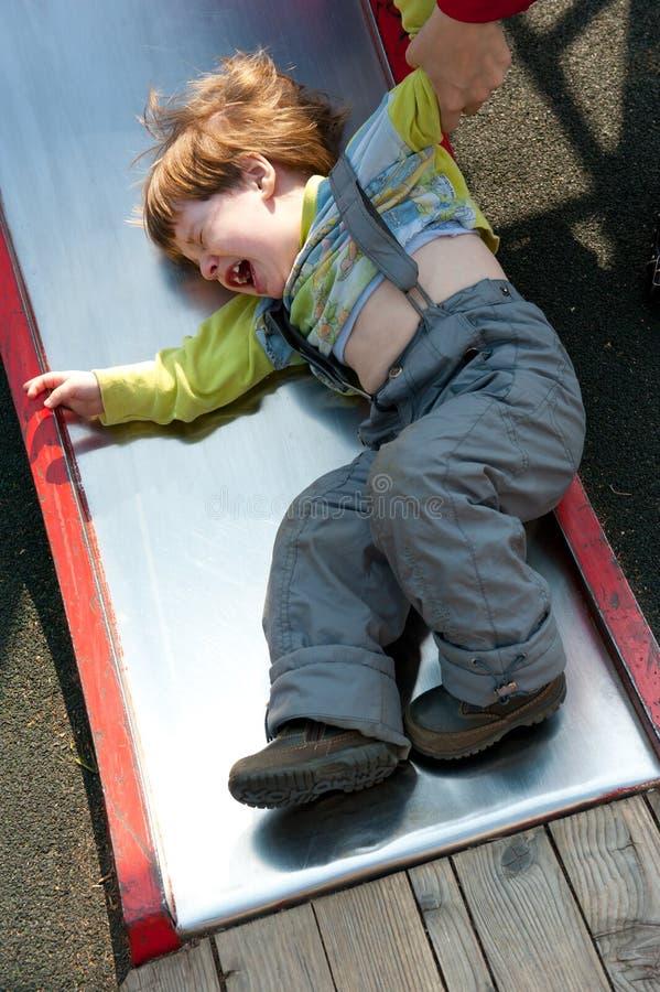 Stubborn naughty boy crying stock photography