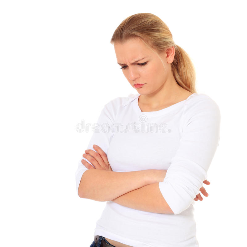 Stubborn young woman. Portrait of a stubborn young woman. All on white background royalty free stock images