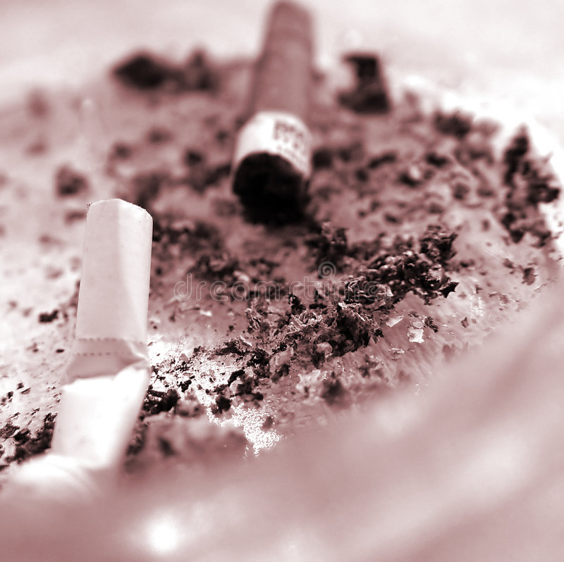 Stubs in an ashtray. The smoking it is harm for health. It is time to stop stock photography