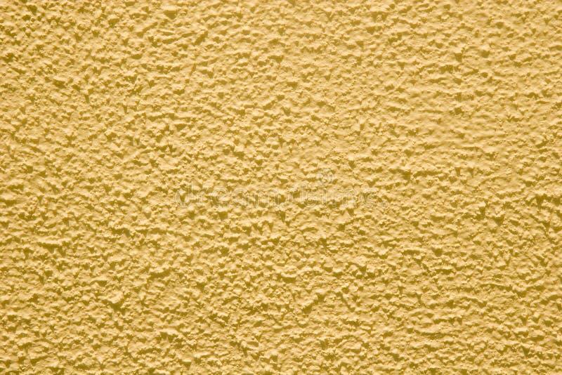Stuc jaune photo libre de droits